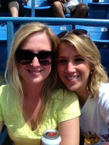 Two girls at a baseball game