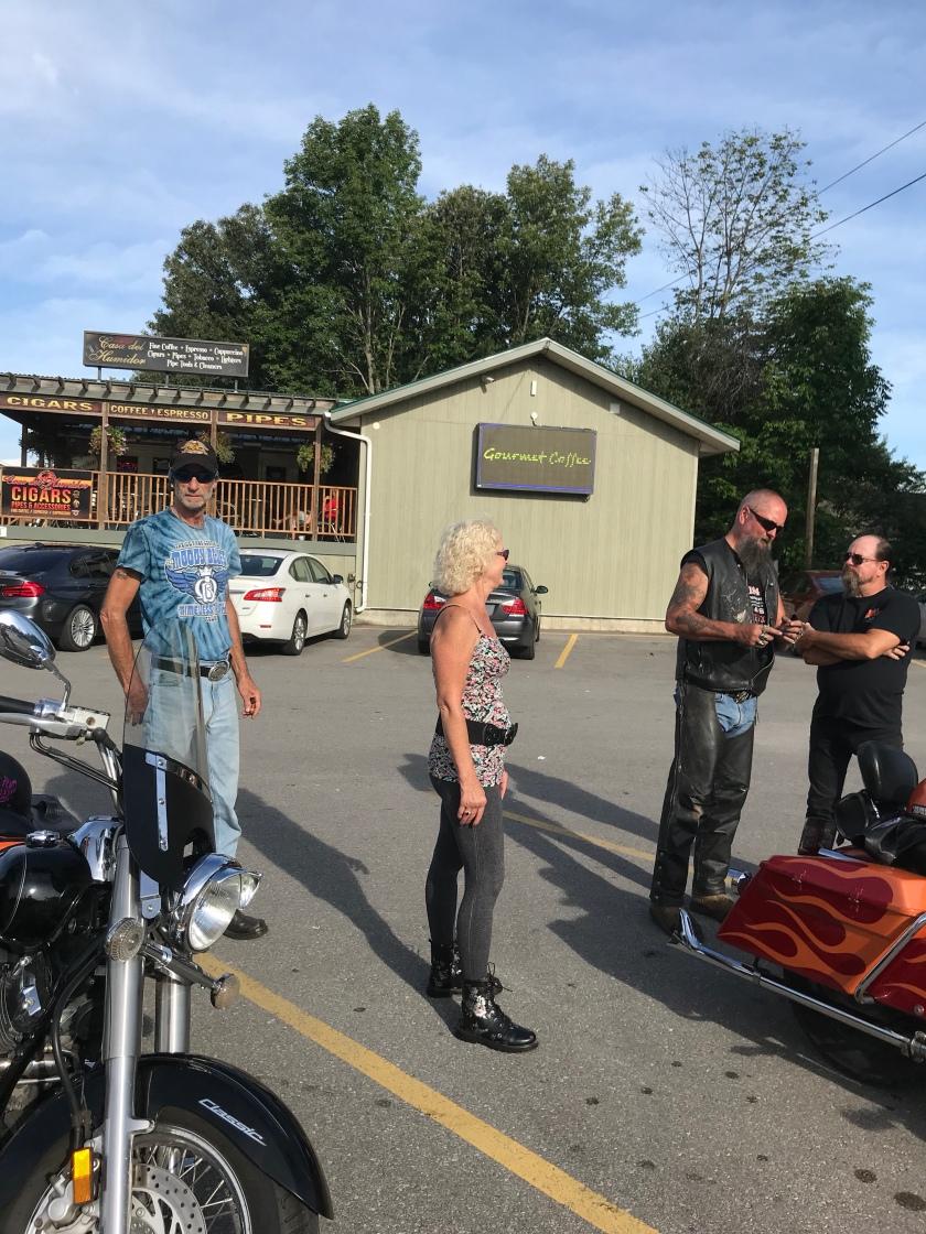 People standing beside motorcycles