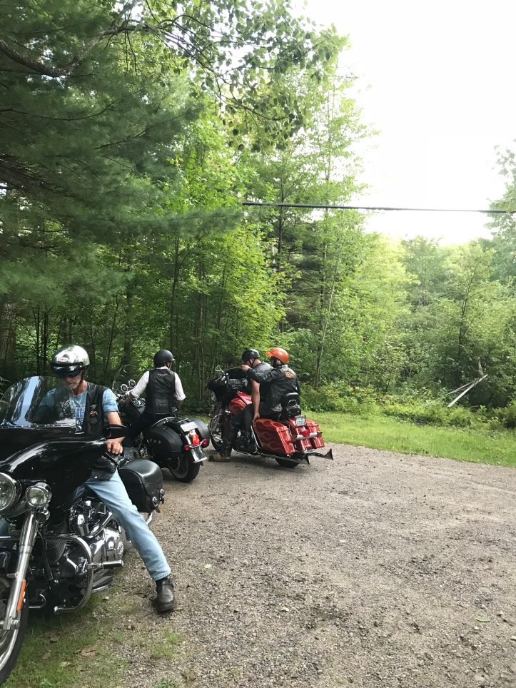 Riders on motorcycles in driveway