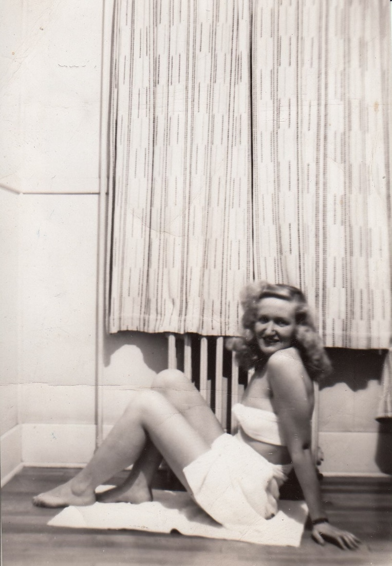 blond woman 1940 ish? bikini of the day, white top with white skirt bottom